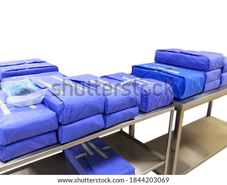 Wrapped Sterile Surgical Instruments Sets In Table Royalty-Free Stock Photo #1844203069