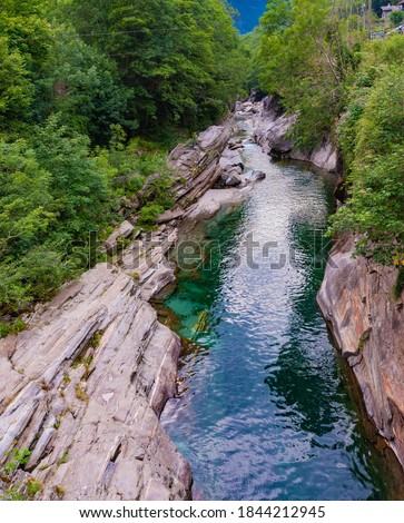 Europe.Switzerland.Crystal clear, turquoise river Verzasca.Water among stones.There are many trees on the banks. Royalty-Free Stock Photo #1844212945
