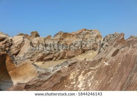 Ancient meteoroid Rocks beside river