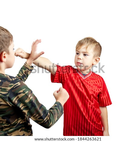 On white isolated background two boy athlete training block against punch and punch Royalty-Free Stock Photo #1844263621