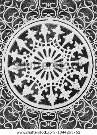 Seamless pattern in wrought iron design. Ethnic ornament. Perfect symmetry texture. Curved doodling motif. Binary monochrome black and white art.  Ironwork fantasy.