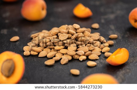 Some shelled Apricot Kernels as detailed close up shot (selective focus) Royalty-Free Stock Photo #1844273230