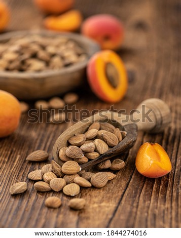 Vintage wooden table with a portion of shelled Apricot Kernels (close up shot; selective focus) Royalty-Free Stock Photo #1844274016