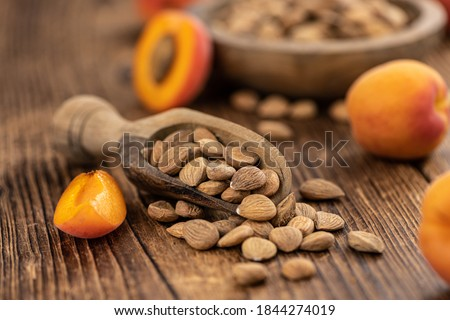 Some shelled Apricot Kernels as detailed close up shot (selective focus) Royalty-Free Stock Photo #1844274019