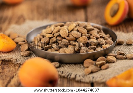 Some shelled Apricot Kernels as detailed close up shot (selective focus) Royalty-Free Stock Photo #1844274037