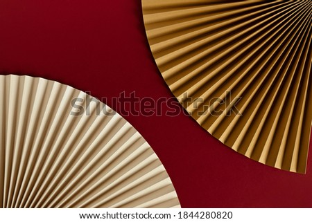 Template with paper fans over red background, Chinese New Year, Christmas, New year Background. Mockup for product presentation, flat lay, top view Royalty-Free Stock Photo #1844280820