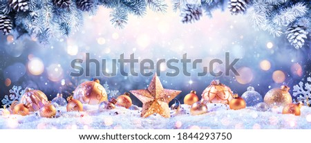 Abstract Christmas Card - Golden Ornament On snow With Fir Branches And Defocused Lights - contain Illustration Royalty-Free Stock Photo #1844293750