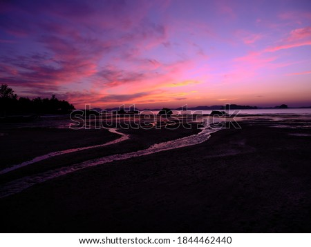 Twilight silhouette seascape view, line of beauty on the beach, with colorful twilight coulds and sky, so beautiful, space for the text Royalty-Free Stock Photo #1844462440