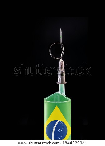 syringe or medical injection with flag of brazil on black background. Spot focus on the needle. Concept of crisis in Brazilian health in SUS - unique health system