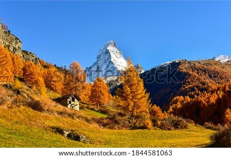 Autumn mountain peak snow landscape. Mountain cabin in autumn mountains. Mountain peak snow in autumn mountains. Autumn mountains landscape #1844581063