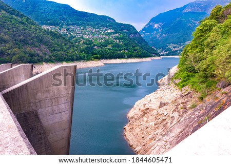 Europe.Switzerland.Dam on the Verzasca River.Valley of Verzasca surrounded by the Alps.Crystal clear water. Royalty-Free Stock Photo #1844605471