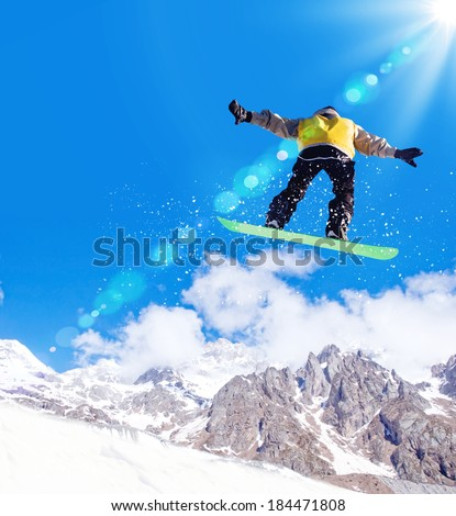Man on snowboard jumping in sky. Summer vacation #184471808