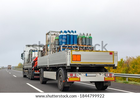 Transportation of cylinders with oxygen for patients with coronavirus. Truck delivering gas cylinders for medical purposes  Royalty-Free Stock Photo #1844799922