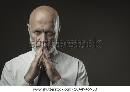 Confident senior corporate businessman staring at camera and posing, leadership and individuality concept Royalty-Free Stock Photo #1844945953