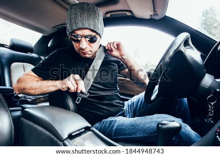 Adult caucasian man wearing seat belt in car before driving - safety rules Royalty-Free Stock Photo #1844948743