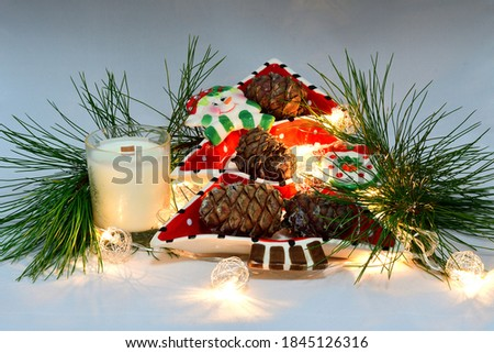 Scented wax candles, Christmas toy, stand, pine cones, cedar branch, Christmas garland, composition, comfort, atmosphere of comfort and peace #1845126316