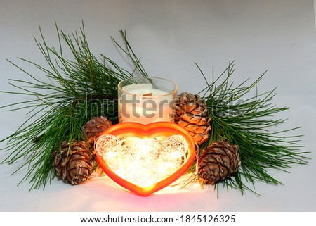 Scented wax candles, Christmas toy heart, cedar cones, cedar branch, Christmas garland, composition, comfort, atmosphere of comfort and peace #1845126325