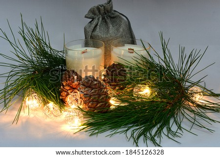 Scented wax candles, canvas bag, pine cones, cedar branch, Christmas garland, composition, aromatherapy, comfort, atmosphere of comfort and peace #1845126328