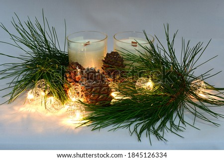 Scented wax candles, cedar cones, cedar branch, Christmas garland, composition, aromatherapy, comfort, atmosphere of comfort and peace #1845126334