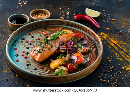 Grilled Salmon with cooked Vegetables, Keto friendly salmon with vegetables diet dish. Paleo, keto, fodmap, dash diet. Healthy concept, gluten free, lectine free Royalty-Free Stock Photo #1845136990
