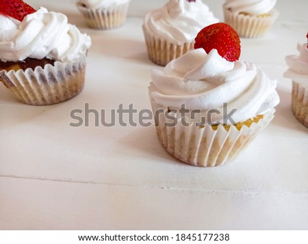 Photo of homemade strawberry cupcakes. Vanilla and strawberry cupcakes picture. Food background photography.