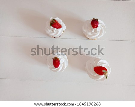 Photo of homemade vanilla cupcakes. Vanilla cupcakes with strawberry decorating. Picture of horizontal view cupcakes background. Sweet food with White background photography.