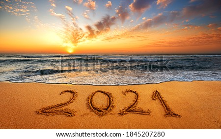 Happy New Year 2021! Written 2021 on the beach. Happy New Year 2021 is coming concept sandy.f #1845207280