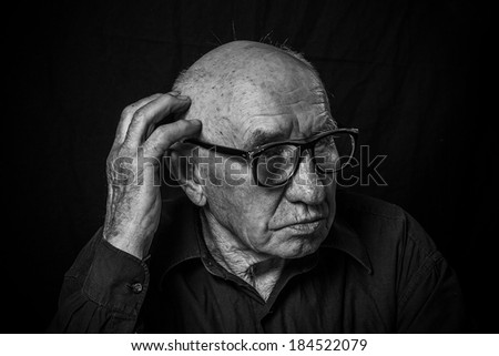 Artistic portrait of an old man with glasses #184522079