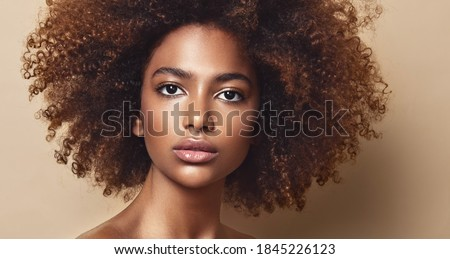 Beauty portrait of african american girl with clean healthy skin   Beautiful and serious black woman.Curly afro hair Royalty-Free Stock Photo #1845226123