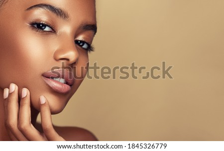 Beauty portrait of African American girl . Beautiful black woman touch her face . Facial  treatment . Cosmetology , skin care  and spa .  Royalty-Free Stock Photo #1845326779