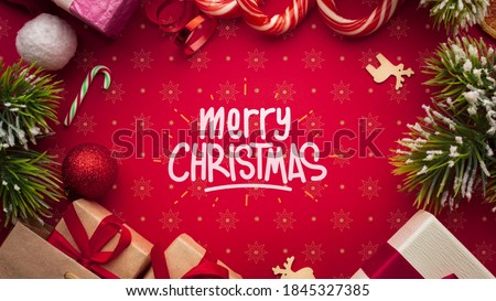 Gifts, decorations, lollipops, Christmas magic, on a red background. Happy New 2021