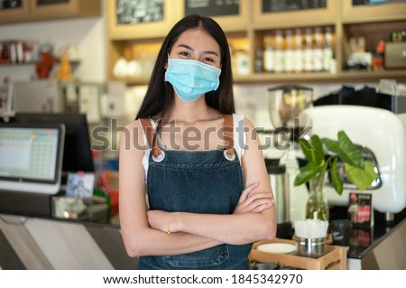 New generation women wearing a face mask do small business in coffee shop counter Royalty-Free Stock Photo #1845342970