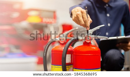 Engineer checking Industrial fire control system,Fire Alarm controller, Fire notifier, Anti fire.System ready In the event of a fire. #1845368695
