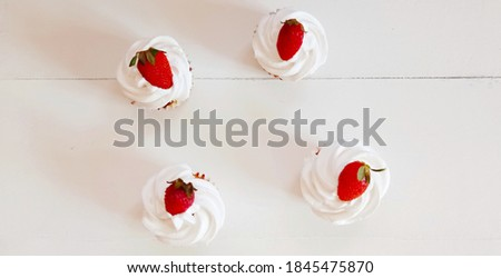 Picture of homemade vanilla cupcakes. Cream shantilly cupcakes. Baked at home. Delicious sweet cupcakes with white background photography. Strawberry decorating cupcakes. Yummy food.