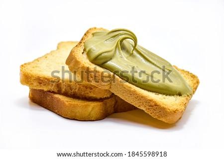 toast with pistachio cream lying on plain toasts isolated on white. Royalty-Free Stock Photo #1845598918