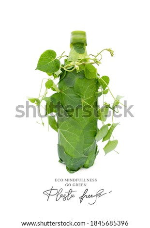 Plastic free.Ecological poster. Say NO to plastic. Ban plastic pollution. Biodegradable bottle, made with green sprout and leaves. Zero waste and Sustainable lifestyle. Think Green.