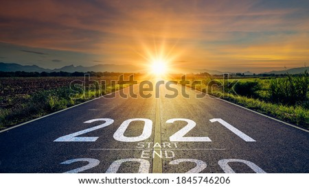 New year 2021 or start straight concept.word 2021 written on the road in the middle of asphalt road at sunset.Concept of planning and challenge or career path,business strategy,opportunity and change #1845746206
