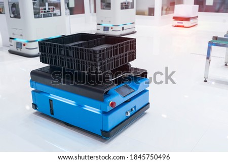 warehouse robot car carries cardboard box assembly in factory Royalty-Free Stock Photo #1845750496