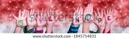 Children Hands Building Word Give Hope, Red Christmas Background