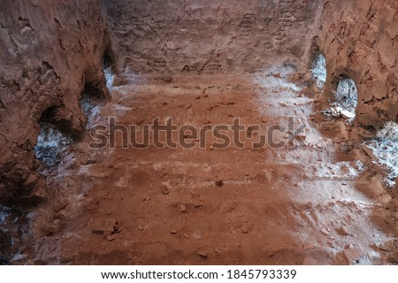 Traditional roofing tiles factory in the country side of Indonesia. Tiles made of clay are usually burned in a large furnace. Detail inside of high burning furnace built of red brick arrangement. #1845793339