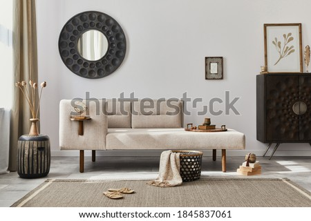 Modern ethnic living room interior with design chaise lounge, round mirror, furniture, carpet, decoration, stool and elegant personal accessories. Template. Stylish home decor. Royalty-Free Stock Photo #1845837061