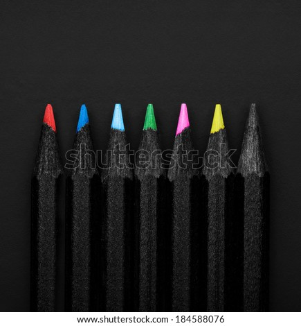 Set beautiful black, colored pencils of colored pencils on black background. Soon to school. Back to School