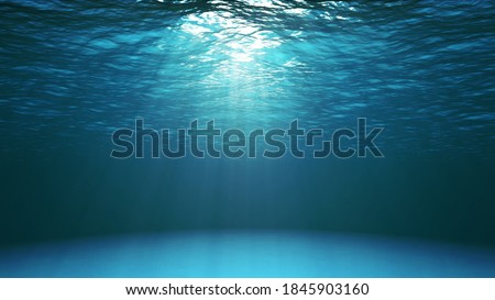 Blue ocean surface seen from underwater. Abstract waves underwater and rays of sunlight shining through water Royalty-Free Stock Photo #1845903160