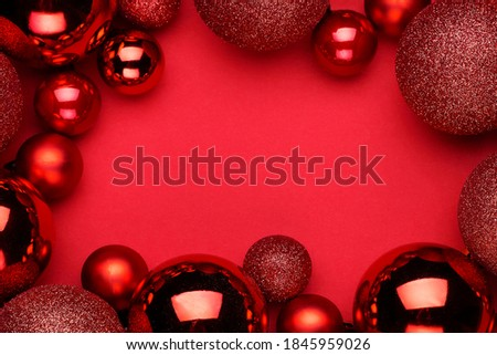 Christmas ornament on the red background. Top view with copy space for your text. Royalty-Free Stock Photo #1845959026