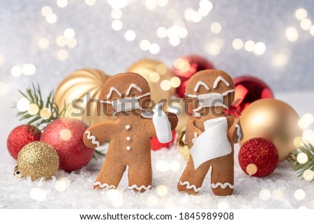 Stay home quarantine from Covid-19. Christmas gingerbread men with a masks Royalty-Free Stock Photo #1845989908