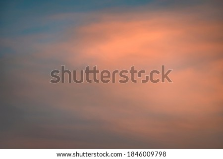 Cloud in the sky at sunset texture background. Red, orange and blue abstract shades. True high resolution photography