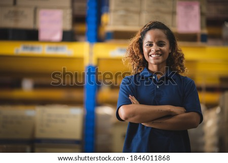 Portrait of African American worker in warehouse, International export business concept Royalty-Free Stock Photo #1846011868