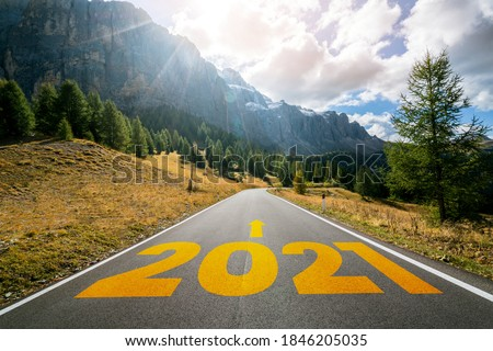 2021 New Year road trip travel and future vision concept . Nature landscape with highway road leading forward to happy new year celebration in the beginning of 2021 for fresh and successful start . #1846205035