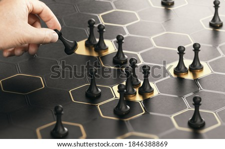 Conceptual board game with a hand moving pawns. Black and golden background. Concept of market positioning or business strategy. Composite image between a hand photography and a 3D background. Royalty-Free Stock Photo #1846388869