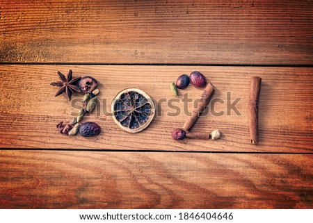 2021 written with Christmas spices and dried fruits on wooden background, new year greeting card Royalty-Free Stock Photo #1846404646